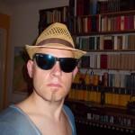 Literat mit Sonnenbrille und Hut, Norbert W. Schlinkert